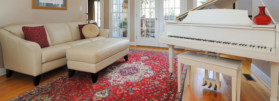 Oriental carpet in room with piano
